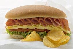 Sub sandwich and crisps on sandwich wrap