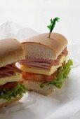 Sub sandwich, halved, on sandwich wrap