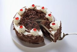 Black Forest gateau, a piece cut, with piece on server