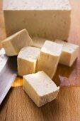 Block of tofu, diced tofu and Asian knife