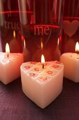 Burning heart-shaped candles for Valentine's Day