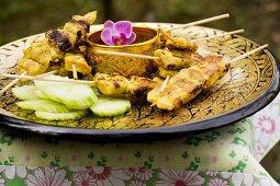 Saté with peanut sauce and cucumber (Thailand)