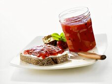 Passion fruit and strawberry jam on bread and in jar