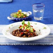 Turkey chili con carne with rice and diced avocado