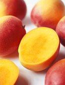 Mangos, one halved