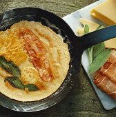 Omelette with bacon, sage and cheese