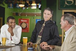 Three men at the bar in a pub
