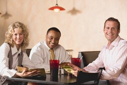 Three people at table in a restaurant