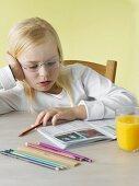 Bored girl reading a school book