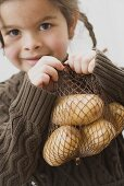 Girl with a bag of potatoes