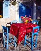 Table and blue chairs on a terrace
