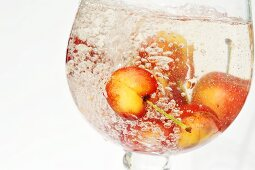 Sweet cherries in a glass of water
