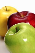 One green, one red and one yellow apple