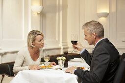 Mature married couple having a meal