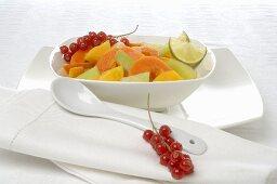 Fruit salad in a white porcelain dish