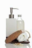 Liquid soap, pumice stone and towel