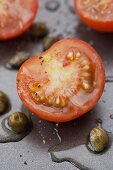 Halved cherry tomatoes with capers and vinaigrette