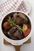 Braised oxtail with tomatoes, garlic and rosemary