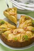 Apple cake with chopped pistachios, a slice cut