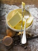 Baking ingredients (butter, eggs), pastry brush, fork