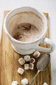 Cup of cocoa (almost empty) with marshmallows