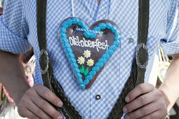 Man with Lebkuchen heart at Oktoberfest