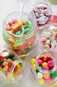 Assorted sweets in storage jars