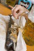 Steckerlfisch (fish on stick), litre of beer (Oktoberfest, Munich)