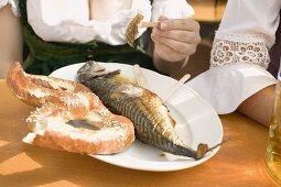 Steckerlfisch (fish on stick) & pretzel (Oktoberfest, Munich)