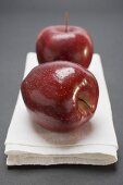Two red apples, variety Stark, on linen cloth