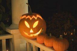 Pumpkin lantern and orange pumpkins for Halloween
