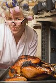 Despairing housewife with burnt turkey