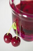 Cherry jelly in small jelly mould, fresh cherries beside it