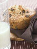 Chocolate chip muffin, glass of milk