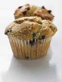 Two blueberry muffins in paper cases