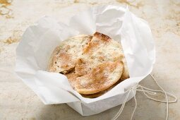 Caramelised aniseed biscuits in paper (Spain)
