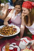 Young women at a 4th of July picnic (USA)