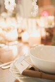 Christmas place-setting with place card by candlelight