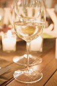 Glass of white wine on Christmas table