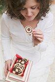 Woman taking pinwheel biscuit out of box