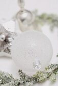 White Christmas bauble and silver decorations