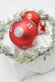Christmas tree ornaments and wreath on Christmas parcel