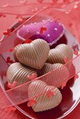 Purple fabric heart and chocolates for Valentine's Day