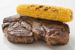 Grilled beef steak with corn on the cob