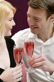 Couple clinking glasses of sparkling wine