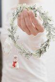 Woman holding Christmas decoration