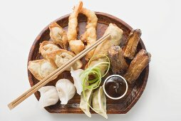 Plate of Asian appetisers with dip