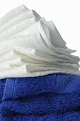 A stack of white and blue towels