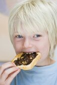 Boy eating Vegemite on toast (Australia)