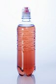 Red energy drink in plastic bottle